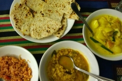 Roti, coconut sambol, potato curry and dal